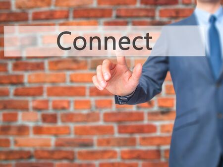 Connect - Businessman press on digital screen. Business,  internet concept. Stock Photo