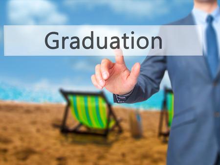 general knowledge: Graduation - Businessman press on digital screen. Business,  internet concept. Stock Photo