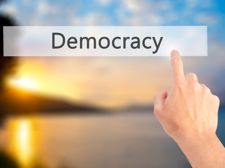 parliamentary: Democracy - Hand pressing a button on blurred background concept . Business, technology, internet concept. Stock Photo