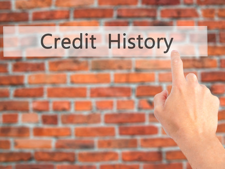 history background: Credit History - Hand pressing a button on blurred background concept . Business, technology, internet concept. Stock Photo