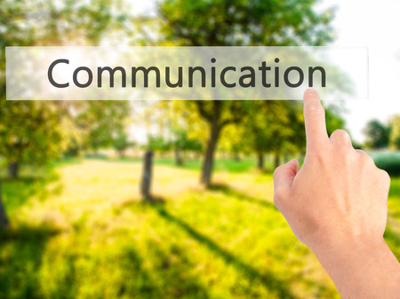 Communication - Hand pressing a button on blurred background concept . Business, technology, internet concept. Stock Photo