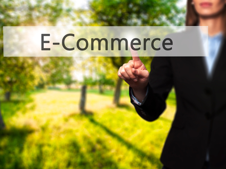 E-Commerce - Isolated female hand touching or pointing to button. Business and future technology concept. Stock Photo