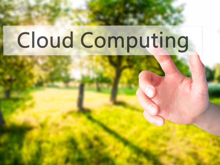 definicion: Cloud Computing - Hand pressing a button on blurred background concept . Business, technology, internet concept. Stock Photo Foto de archivo