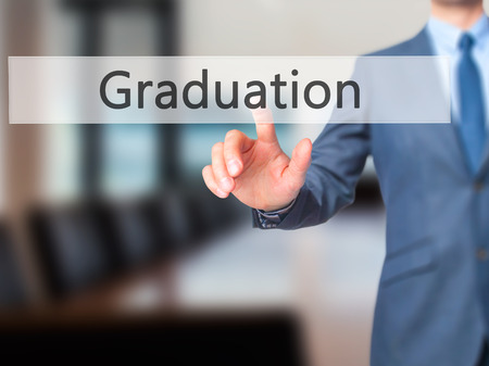 university admission: Graduation - Businessman press on digital screen. Business,  internet concept. Stock Photo
