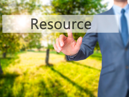 resourcefulness: Resource - Businessman press on digital screen. Business,  internet concept. Stock Photo Stock Photo
