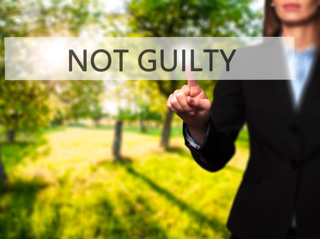 NOT GUILTY - Isolated female hand touching or pointing to button. Business and future technology concept. Stock Photo Stock Photo