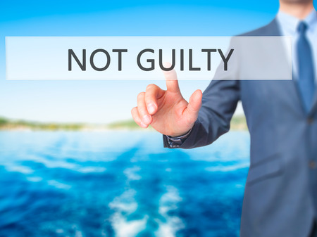 NOT GUILTY - Businessman press on digital screen. Business,  internet concept. Stock Photo
