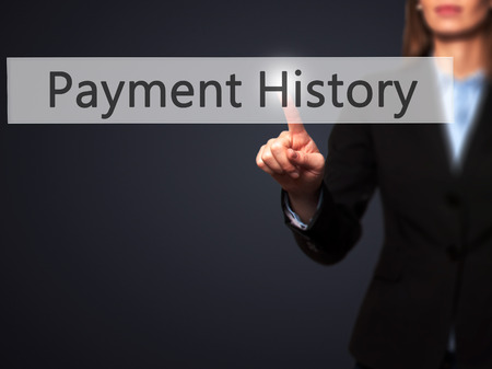 customer records: Payment History - Isolated female hand touching or pointing to button. Business and future technology concept. Stock Photo