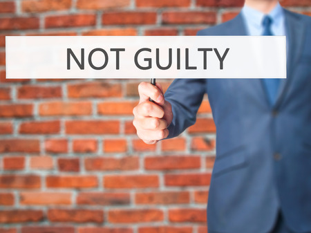NOT GUILTY - Business man showing sign. Business, technology, internet concept. Stock Photo Stock Photo