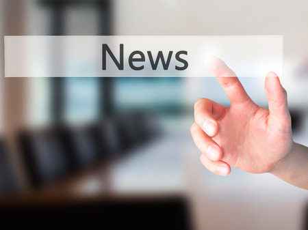 actuality: News - Hand pressing a button on blurred background concept . Business, technology, internet concept. Stock Photo Stock Photo
