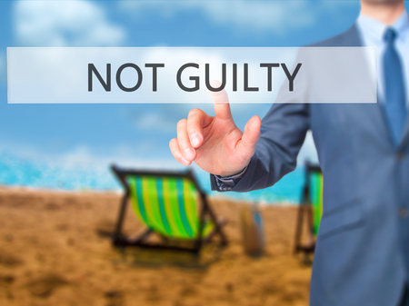white backing: NOT GUILTY - Businessman press on digital screen. Business,  internet concept. Stock Photo