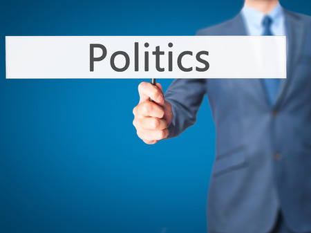 nomination: Politics - Business man showing sign. Business, technology, internet concept. Stock Photo