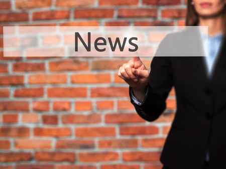 News - Isolated female hand touching or pointing to button. Business and future technology concept. Stock Photo