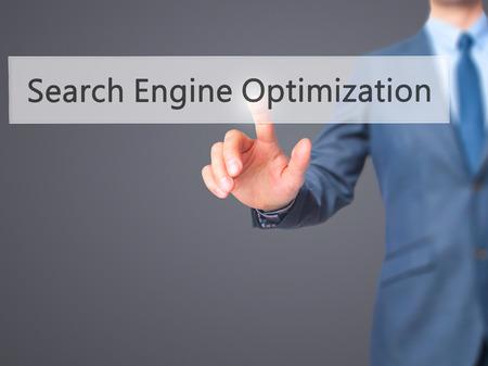 keywords link: Search Engine Optimization - Businessman press on digital screen. Business,  internet concept. Stock Photo Stock Photo