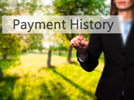 Payment History - Isolated female hand touching or pointing to button. Business and future technology concept. Stock Photo