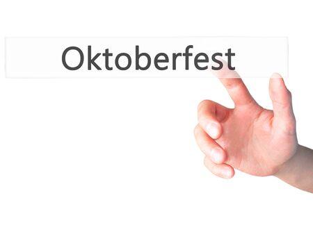 bier festival: Oktoberfest - Hand pressing a button on blurred background concept . Business, technology, internet concept. Stock Photo