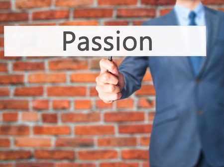 seeking solution: Passion - Businessman hand holding sign. Business, technology, internet concept. Stock Photo