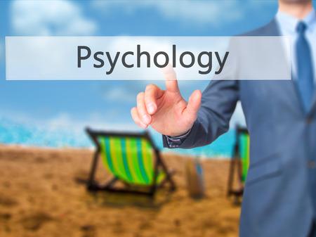 Psychology - Businessman press on digital screen. Business,  internet concept. Stock Photo