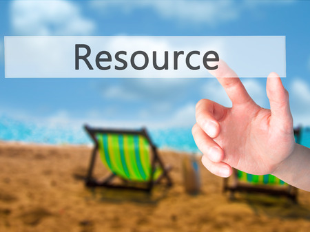 availability: Resource - Hand pressing a button on blurred background concept . Business, technology, internet concept. Stock Photo Stock Photo