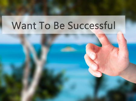 Want To Be Successful - Hand pressing a button on blurred background concept . Business, technology, internet concept. Stock Photo