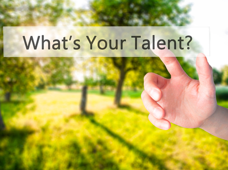 Whats Your Talent ? - Hand pressing a button on blurred background concept . Business, technology, internet concept. Stock Photo