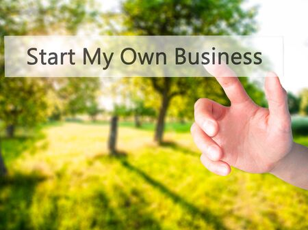 Start My Own Business - Hand pressing a button on blurred background concept . Business, technology, internet concept. Stock Photo