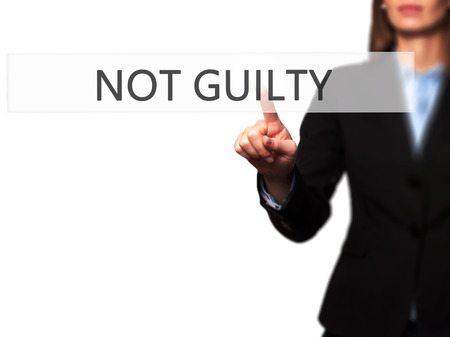 white backing: NOT GUILTY - Isolated female hand touching or pointing to button. Business and future technology concept. Stock Photo Stock Photo