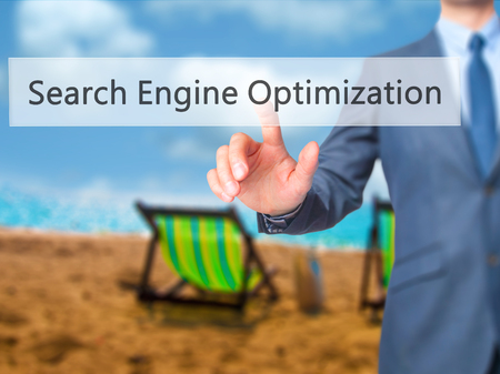 indexing: Search Engine Optimization - Businessman press on digital screen. Business,  internet concept. Stock Photo Stock Photo