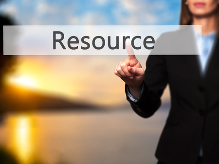 resourcefulness: Resource - Isolated female hand touching or pointing to button. Business and future technology concept. Stock Photo