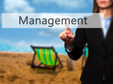 execute: Management - Isolated female hand touching or pointing to button. Business and future technology concept. Stock Photo