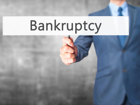Bankruptcy - Business man showing sign. Business, technology, internet concept. Stock Photo
