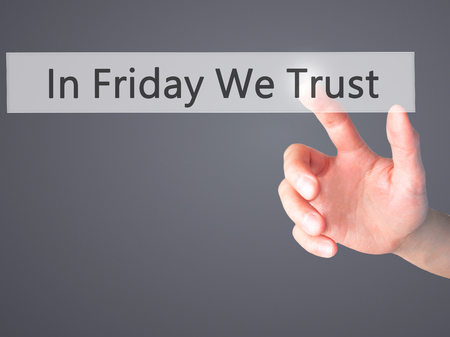 positiveness: In Friday We Trust - Hand pressing a button on blurred background concept . Business, technology, internet concept. Stock Photo