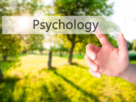 Psychology - Hand pressing a button on blurred background concept . Business, technology, internet concept. Stock Photo Stock Photo