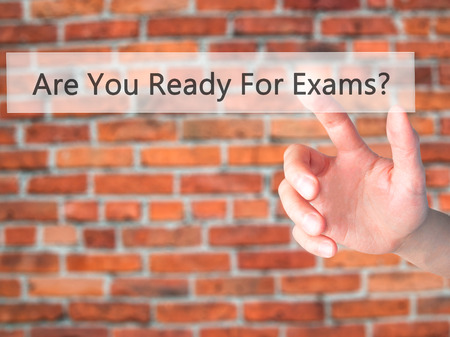 Are You Ready For Exams ? - Hand pressing a button on blurred background concept . Business, technology, internet concept. Stock Photo Stock Photo