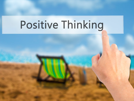 Positive Thinking - Hand pressing a button on blurred background concept . Business, technology, internet concept. Stock Photo