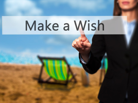 Make a Wish - Businesswoman pressing modern  buttons on a virtual screen. Concept of technology and  internet. Stock Photo