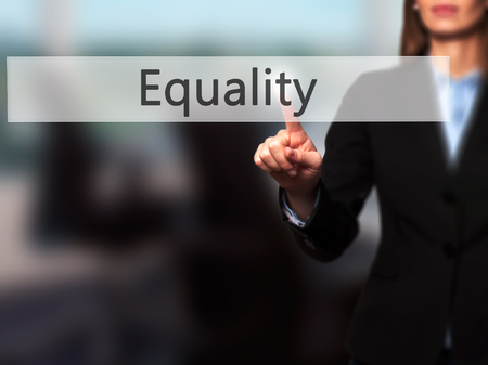 invalidity: Equality - Businesswoman pressing modern  buttons on a virtual screen. Concept of technology and  internet. Stock Photo