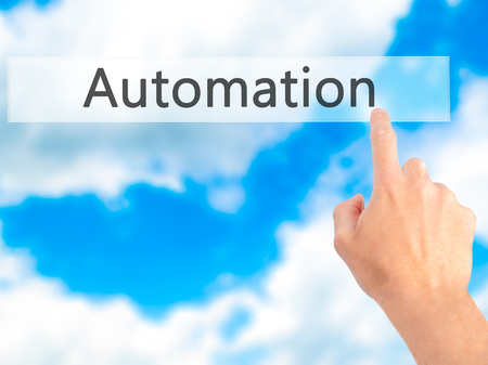 reorganization: Automation - Hand pressing a button on blurred background concept . Business, technology, internet concept. Stock Photo Stock Photo