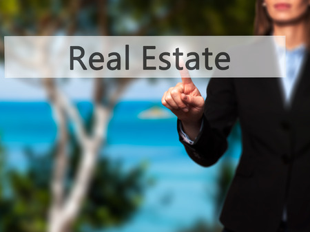 finer: Real Estate - Businesswoman pressing modern  buttons on a virtual screen. Concept of technology and  internet. Stock Photo