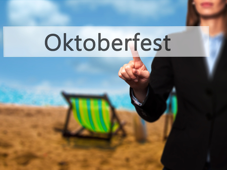Oktoberfest - Businesswoman pressing modern  buttons on a virtual screen. Concept of technology and  internet. Stock Photo