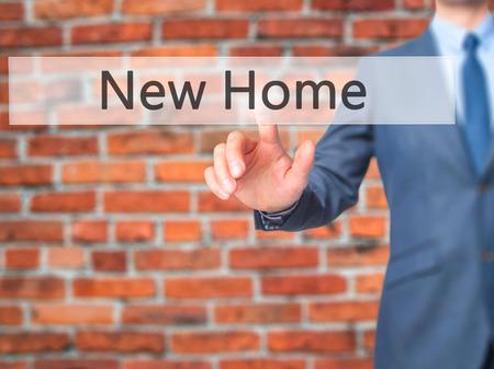 luxacion: New Home - Businessman click on virtual touchscreen. Business and IT concept. Stock Photo Foto de archivo