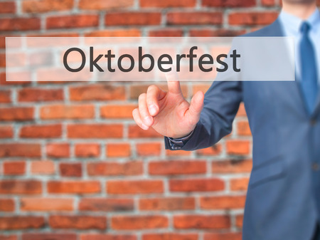 Oktoberfest - Businessman click on virtual touchscreen. Business and IT concept. Stock Photo Stock Photo