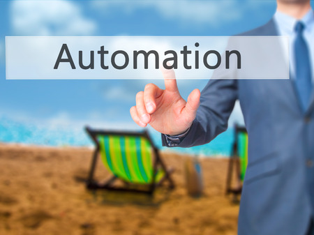 reorganization: Automation - Businessman click on virtual touchscreen. Business and IT concept. Stock Photo