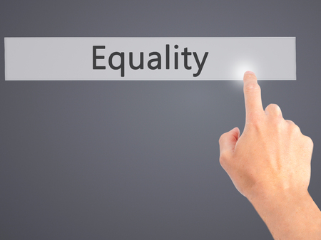 impartial: Equality - Hand pressing a button on blurred background concept . Business, technology, internet concept. Stock Photo Stock Photo