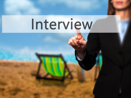 Interview - Businesswoman pressing modern  buttons on a virtual screen. Concept of technology and  internet. Stock Photo Stock Photo