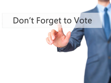 governing: Dont Forget to Vote - Businessman click on virtual touchscreen. Business and IT concept. Stock Photo Stock Photo