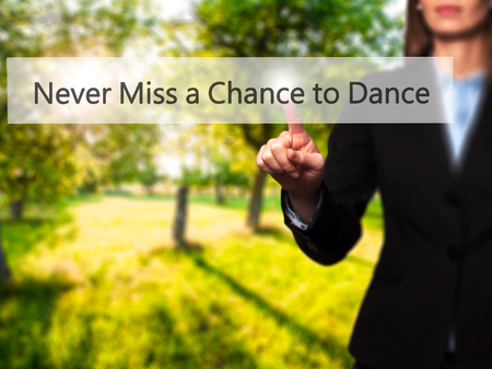 Never Miss a Chance to Dance - Businesswoman pressing modern  buttons on a virtual screen. Concept of technology and  internet. Stock Photo