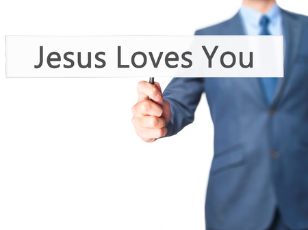 testament schreiben: Jesus Loves You - Businessman hand holding sign. Business, technology, internet concept. Stock Photo Lizenzfreie Bilder