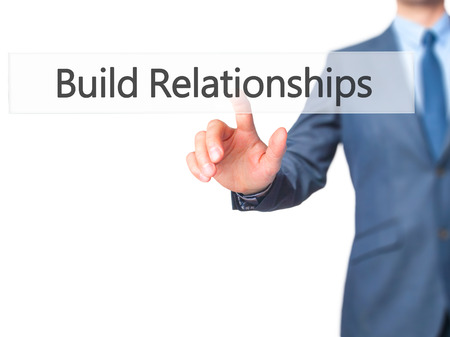 intercessor: Build Relationships - Businessman hand pressing button on touch screen interface. Business, technology, internet concept. Stock Photo