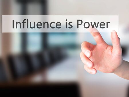 persuaded: Influence is Power - Hand pressing a button on blurred background concept . Business, technology, internet concept. Stock Photo